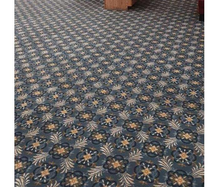 Restaurant Carpet is now a vibrant blue with a floral pattern.